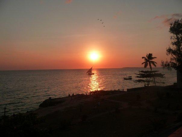 sun setting over Africa